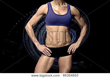 Female bodybuilder against blue design
