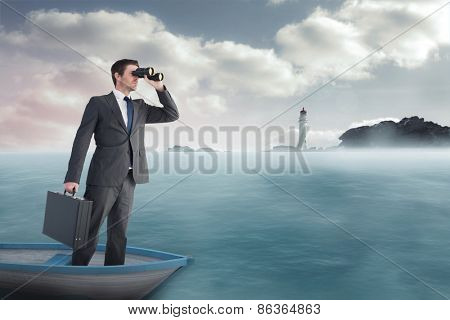 Businessman in boat with binoculars against calm sea with lighthouse