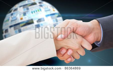 Close up on partners shaking hands against screen sphere showing business advertisement