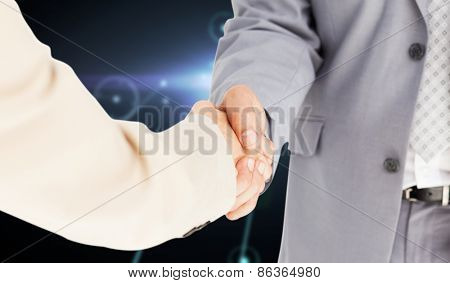 People in suit shaking hands against glowing background with lines