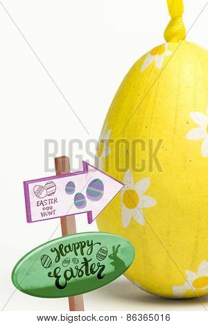 Easter egg hunt sign against yellow easter egg