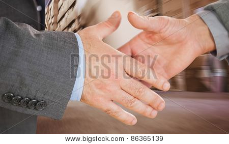 Two people going to shake their hands against worker with fork pallet truck stacker in warehouse