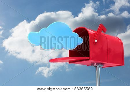 Red email postbox against cloudy sky