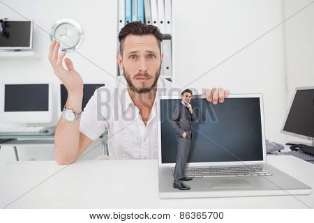 Thinking businessman against confused computer engineer looking at camera with laptop