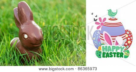 happy easter graphic against chocolate bunny in the grass