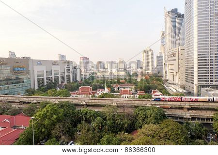Bangkok,thailand-february 17:bangkok Mass Transit System (bts) Pass The Pathumwanaram Temple At Siam