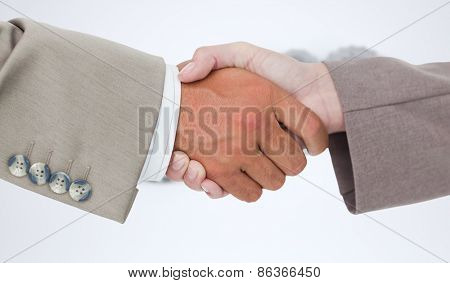 Side view of business peoples hands shaking against cogs and wheels