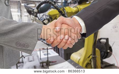 Handshake between two business people against garage