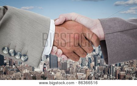 Side view of business peoples hands shaking against new york