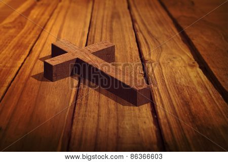 Wooden cross against high angle of wooden planks