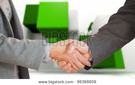 Two people having a handshake in an office against green tile design