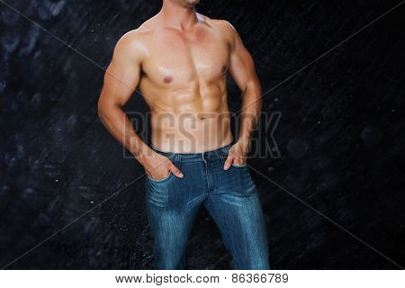 Attractive bodybuilder against black background