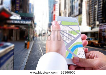 Man using map app on phone against blurry new york street