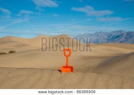 Plastic Shovel In A Sand Dune