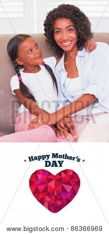 happy mothers day against pretty mother sitting on the couch with her daughter smiling at camera