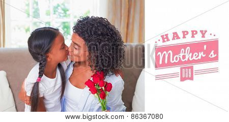 mothers day greeting against pretty mother sitting on the couch kissing her daughter holding roses