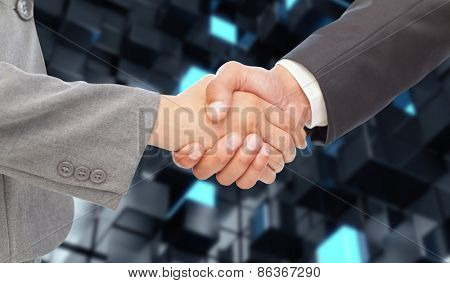 Handshake between two business people against blue and black tile design