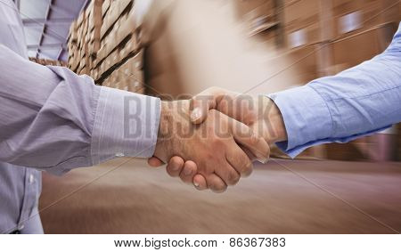 Men shaking hands against worker with fork pallet truck stacker in warehouse
