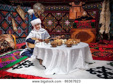 Kazakh Women With Dombra In The Yurt