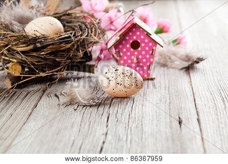 Easter Decoration On Wooden Background With Color Egg And With Birdhouse,