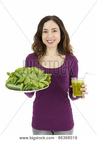 Attractive Caucasian Woman Holding A Green Smoothie Glass And A Vegetable Plate