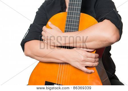 Arms hugging an acoustic guitar isolated on a white background
