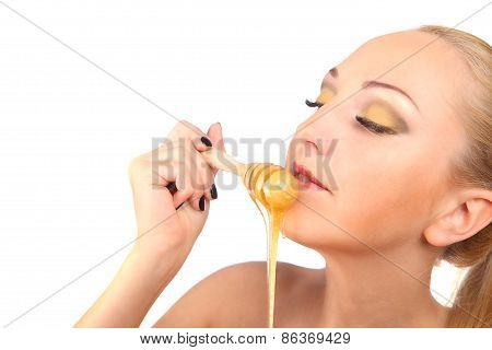 Beautiful Female Body In Honey On White Background