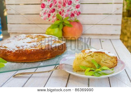 homemade apple pie, strudel, on outdoor rural background