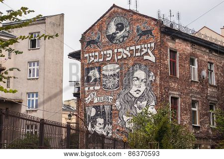 KRAKOW, POLAND - CIRCA AUG, 2014: Mural street art by unidentified artist in jewish quarter Kazimierz. Since the 1818 year Kazimierz is part of the Krakow Old town, now a UNESCO world heritage site.