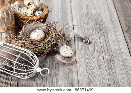 Easter Decoration On Wooden Background With Color Egg And With Birdcage