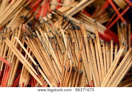 Joss Sticks In The Garbage