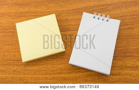 White Memo Note And Sticky Paper Note On Brown Wooden Surface