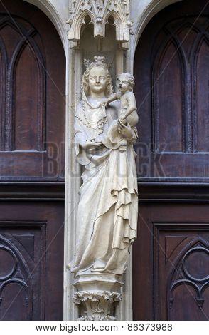 VIENNA, AUSTRIA - OCTOBER 11: Virgin Mary statue from west portal of Minoriten gothic church on October 11, 2014 Vienna.
