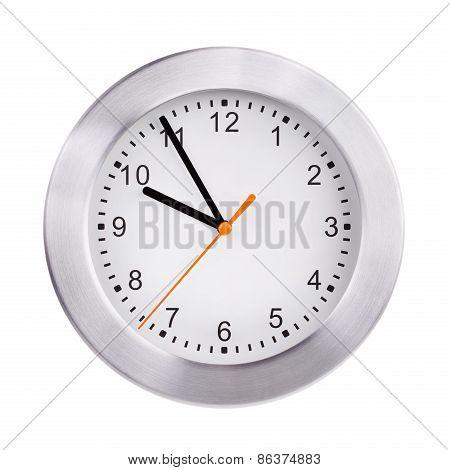 Round clock shows five to ten