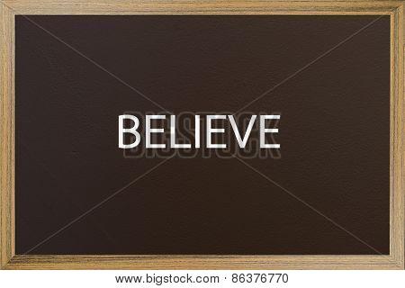 Believe Word On Brown Backboard