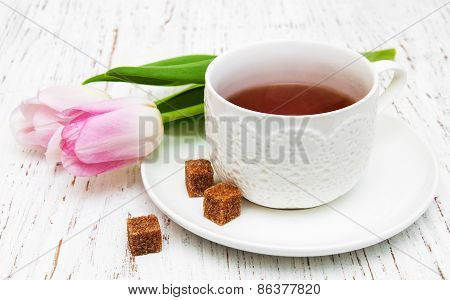 Cup Of Tea And Pink Tulips