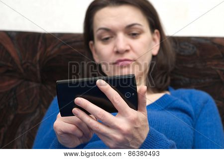Woman Holding  Cell Phone, Focus On Phone