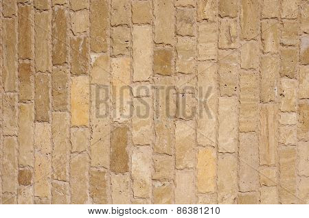 Brown  Stone Vertical Slabs On Wall