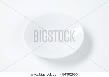 empty white saucer on white background