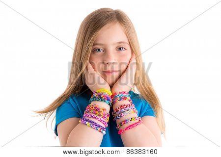 Loom rubber bands bracelets blond kid girl hands on face on white background