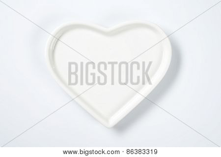 white heart shaped plate on white background