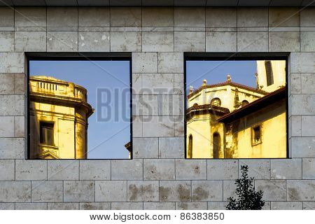 Windows And Reflections On Facade Of Building