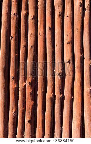 Mediterranean wooden trunks wall texture in Majorca