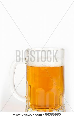 beer into glass on white background
