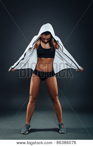 Attractive Athletic Young Woman Posing In Studio On Dark Background