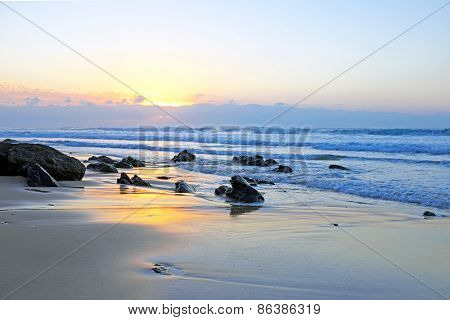 Natural rocks at Praia Vale Figueiras in Portugal at twilight