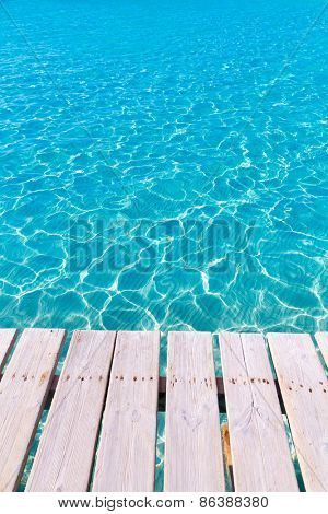 Tropical sea water texture from a wooden pier like paradise summer vacation