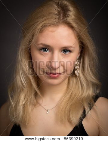 Blond Young Smiling Woman In The Dark