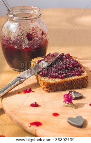 Fresh baked homemade healthy bread with blackcurrant jam - homemade marmalade with fresh organic fru