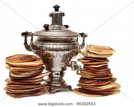 Two piles of pancakes and samovar isolated on white background. Carnival still life.